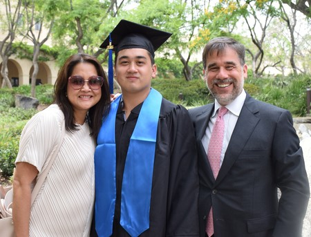 Chris and Rob Holo, pictured with their son, Sam (BS '16)