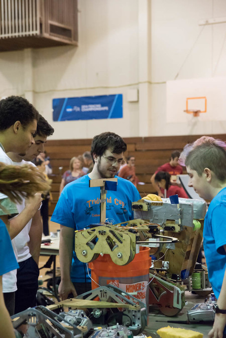 photo of Caltech students working on a robot for the ME72 competition in 2016