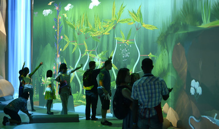 photo of people touring the New York Hall of Science