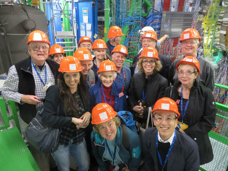 Caltech Associates members in orange hard hats the CERN facility in Switzerland